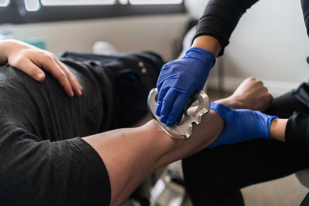 chiropractor service using graston on forearm